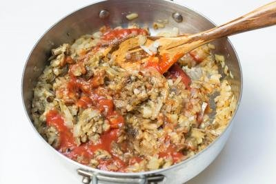 Eggplant and tomato sauce added into the deep skillet with the diced onions