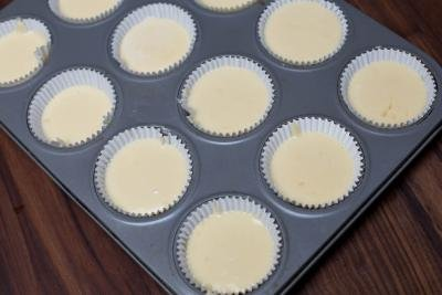 Cupcake batter poured into cupcake pan lined with cupcake liners