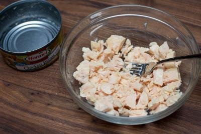 Canned chicken breast removed from the bowl and placed into a bowl