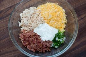 Canned chicken breast, sliced bacon, sliced green onions, cheese and ranch all placed into one bowl