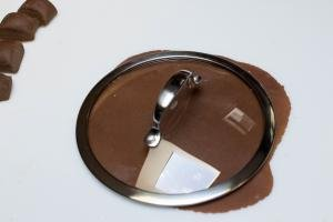 Chocolate Layer Cake layer with a pot lid being used to cut out the cake layer
