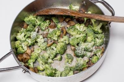 Broccoli and parmesan added to the deep skillet with the mushrooms