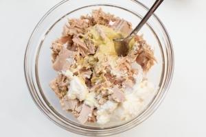 Tuna, mayo and dijon mustard in one bowl