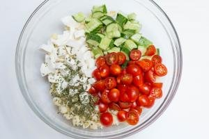 Ingredients for Mozzarella Pasta Salad chopped up in a bowl