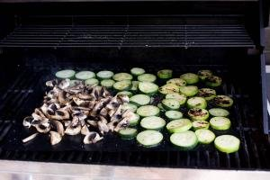 Zucchini and Mushrooms being grilled
