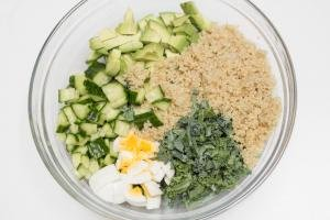 Superfood Quinoa Kale Salad ingredients in a bowl