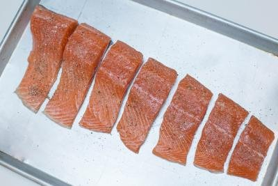 Salmon on a baking pan seasoned