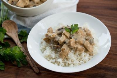 Creamy Chicken Mushroom Gravy in a bowl with rice
