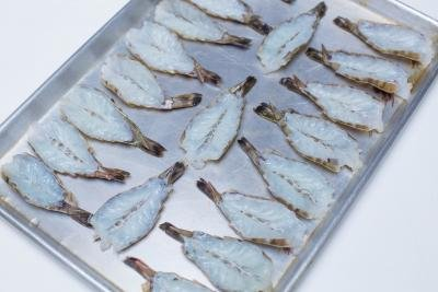 Butterfly shrimp placed on a baking pan