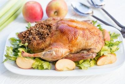 Baked Duck on a serving tray with garnish