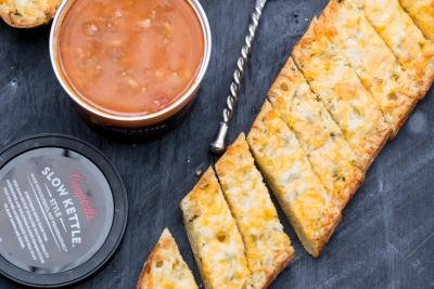 Cheesy Bread on a cutting board with salsa besides it