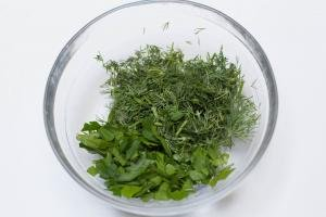 Parsley and dill chopped up in a bowl