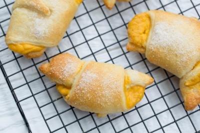 Pumpkin Croissants on a baking rack