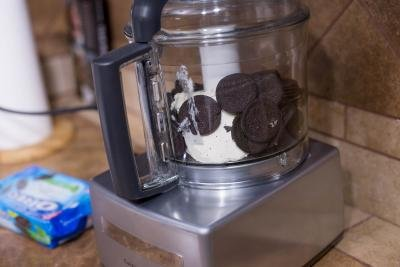 Oreo cookies placed into a food processor