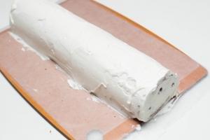 Cream spread all over the cake roll