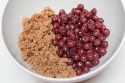 Drunken cherries and cake crumbs in a bowl