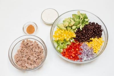 4 bowls one with tuna, one with all the veggies and beans for the Mexican Tuna Salad, one with taco seasoning and one with ranch