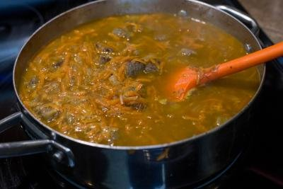 water added to the pot with the beef, onions and carrots