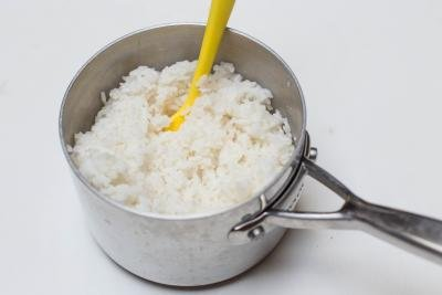 Rice on a pot with a spatula