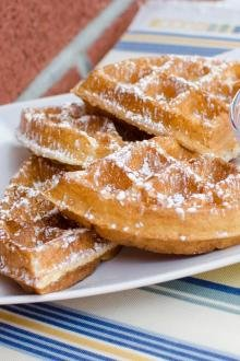Buttermilk Waffles with powdered sugar on a plate