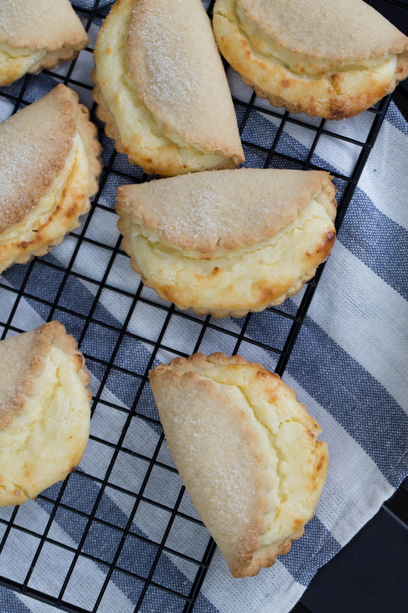 Sweet Cheese Cookies on a baking rack with a kitchen napkin under it