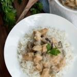 Creamy Chicken Mushroom Gravy on rice on a plate