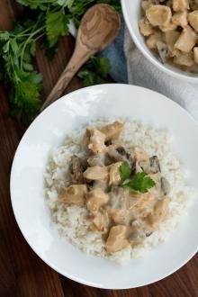 Creamy Chicken Mushroom Gravy on rice on a plate