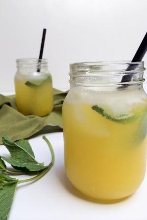 Sparkling Mango Drink in a jar with a straw