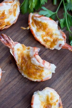 Cheesy Baked Tiger Shrimp on a cutting board