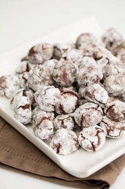 A pile of Chocolate Crinkle Cookies on a plate