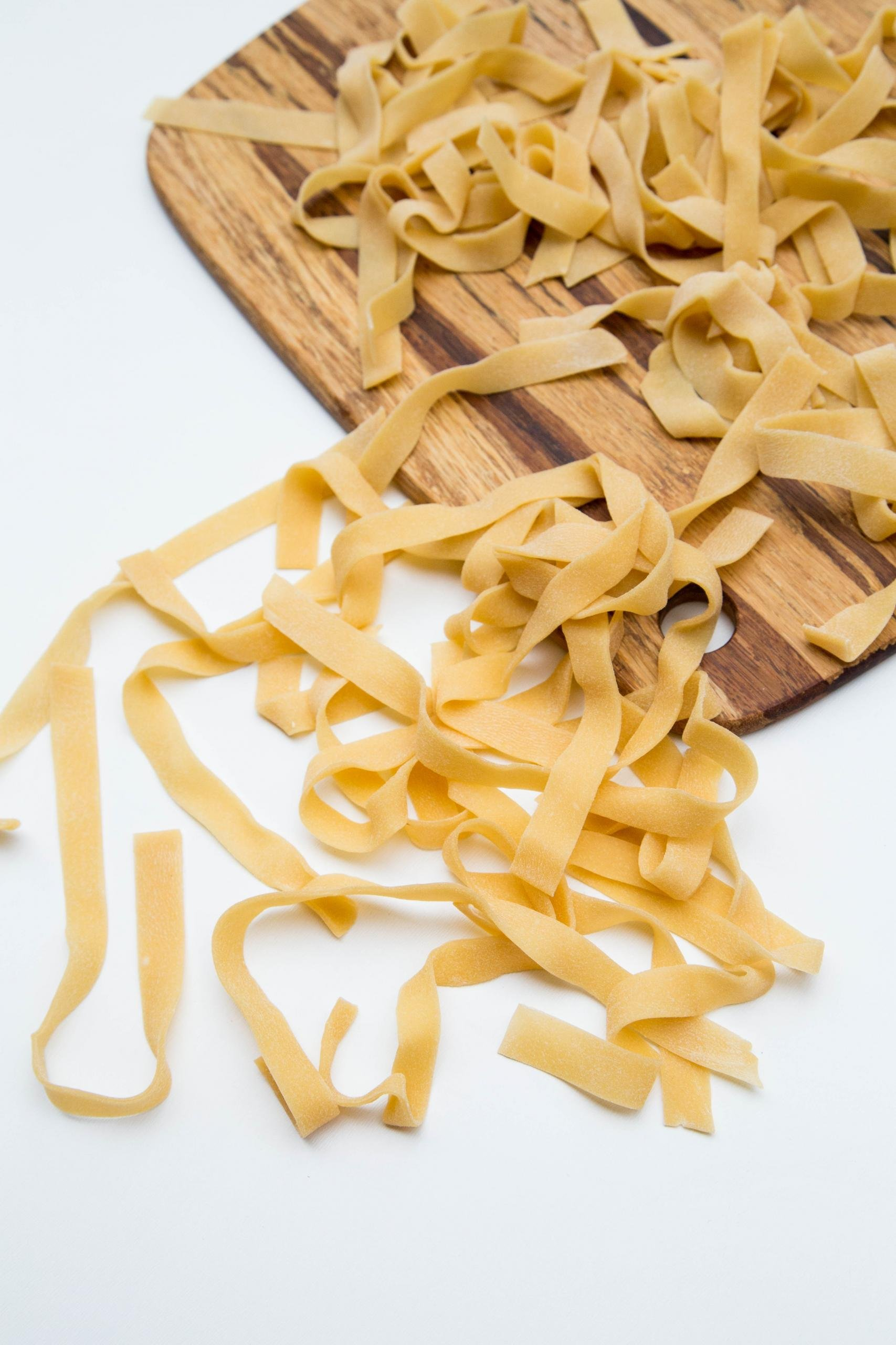Homemade Pasta on cutting board and on the table
