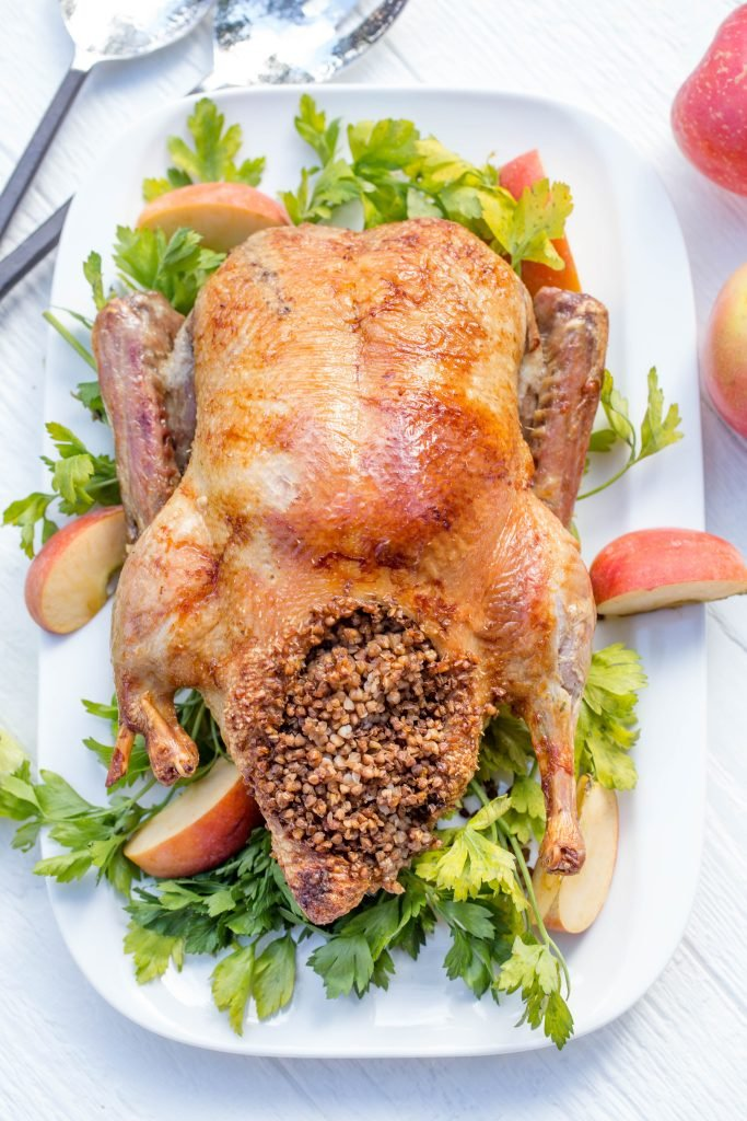Simple Baked Duck on a serving tray with garnish