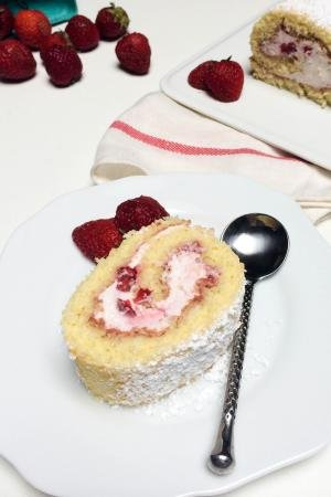 Strawberry Cake Roll slice on a plate