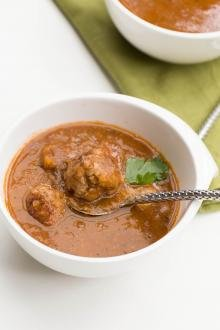 Tomato Lentil Soup with Meatballs in a bowl with a spoon
