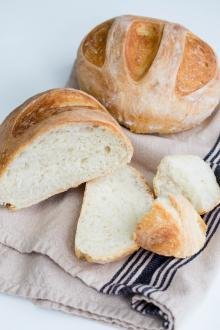 No Knead Bread on a towel on a table