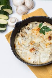 Alfredo Zucchini Bake in a small cast iron pan
