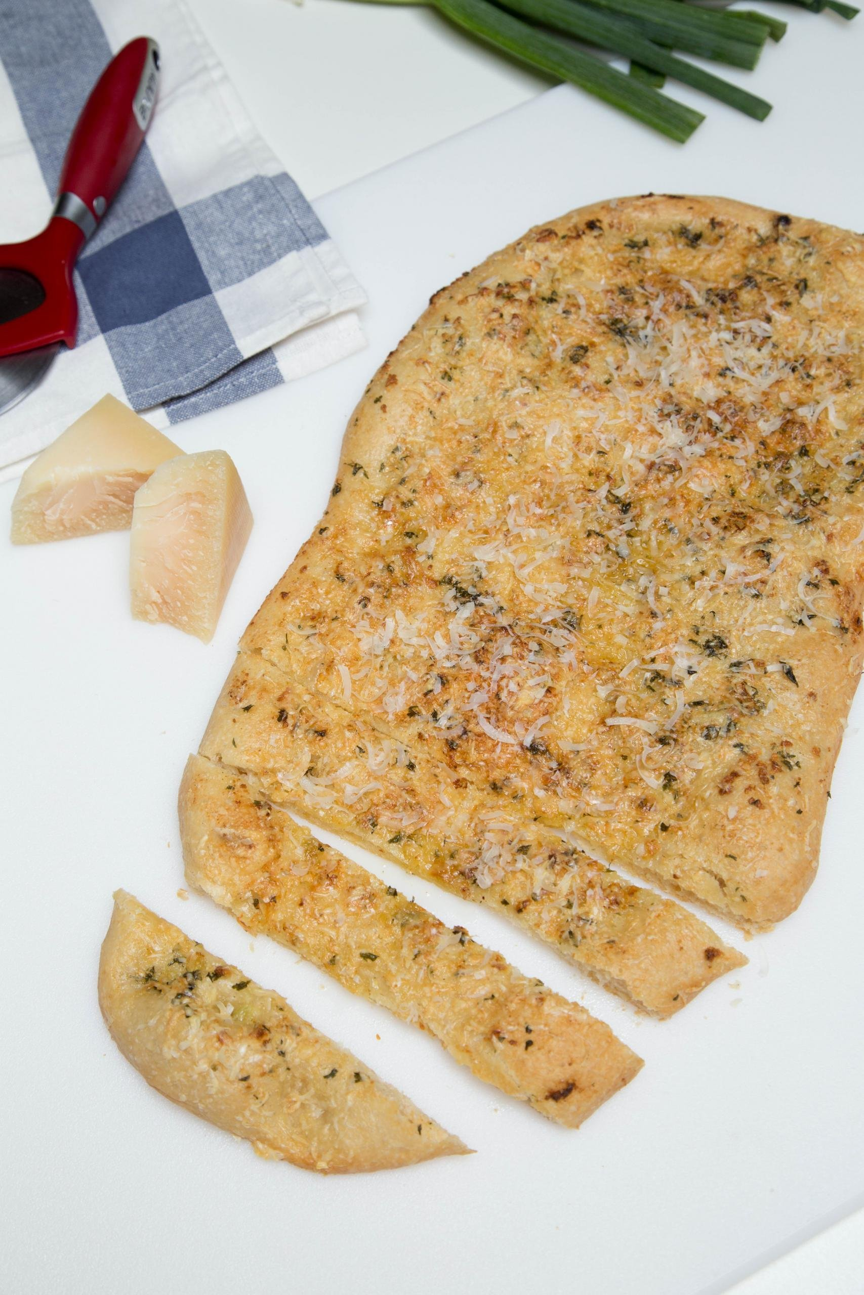 Parmesan Garlic Flatbread cut into long slices