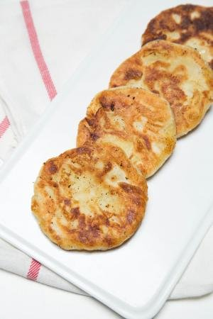 Potato Piroshki in a row on a plate