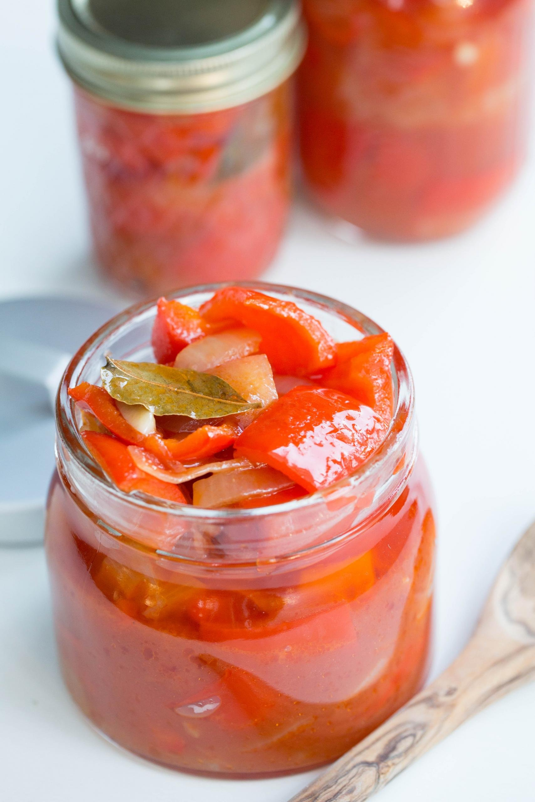 An open jar of marinated red bell peppers