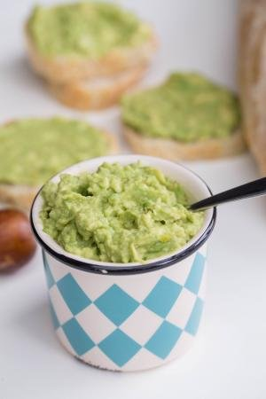 Garlic Avocado Spread in a little condiment container