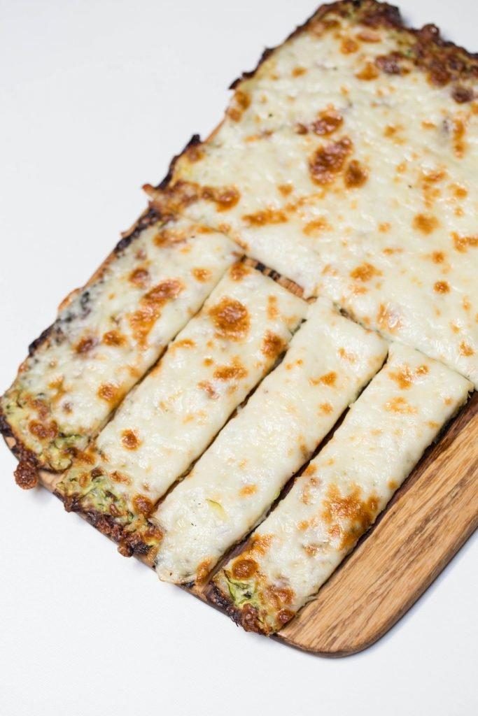 Cheesy Zucchini Breadsticks on a cutting board