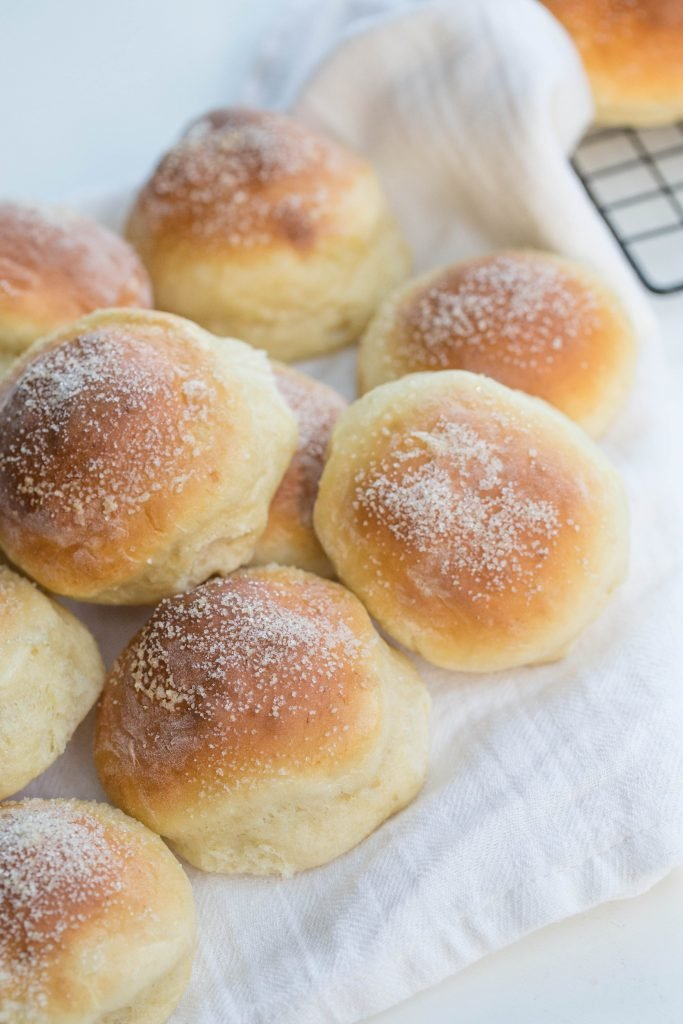 Cottage Cheese Buns on a pile on a table towel