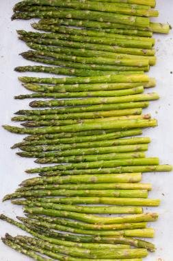 Seasoned Asparagus on a baking pan