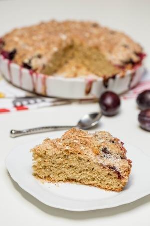 Oatmeal Plum Cake slice on a plate
