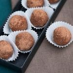 Russian Cake Truffles in cupcake liners on a serving tray and one besides the serving tray