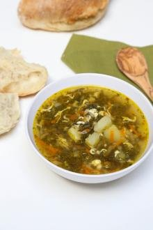 Sorrel Soup in a bowl with bread next to it