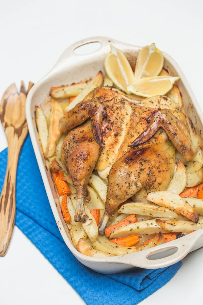 One-Pan Roasted Chicken & Potatoes in a ceramic baking pan