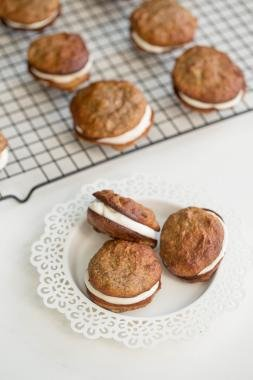 Banana Almond Whoopie Pies on a baking rack in rows and 3 on a small plate