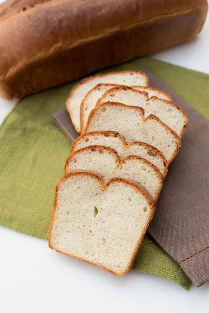 White Country Bread cut into slices and layed out in row