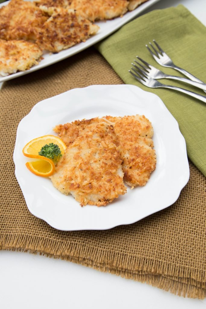 Panko Fish on a plate with a slice of orange